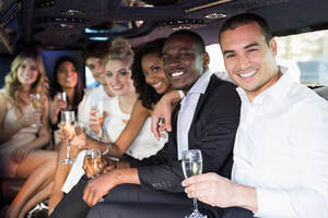 A group of young people drinking in a limo.