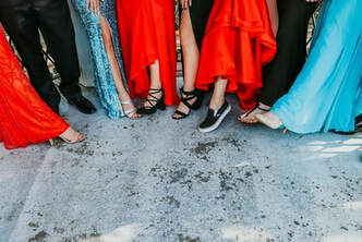 Students showing their outfit and shoes for prom.