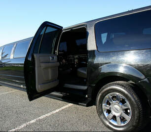 Black stretched limo with the back passenger door open