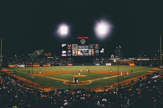 A picture of At&t park at a giants game.