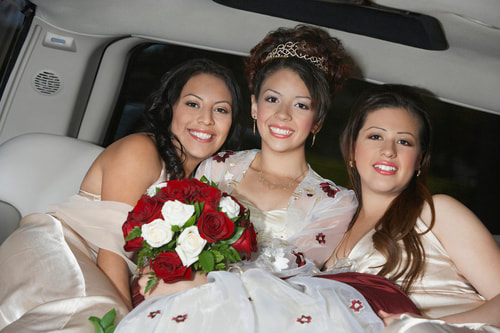 A quinceanera birthday girl in a limo with friends.