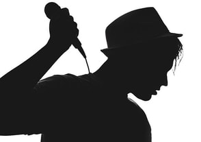 A silhouette of a singer picture image.