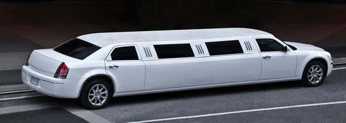 A picture of a white stretch limo.